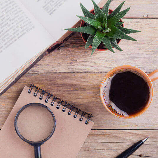 Image of notebook and cup of coffee